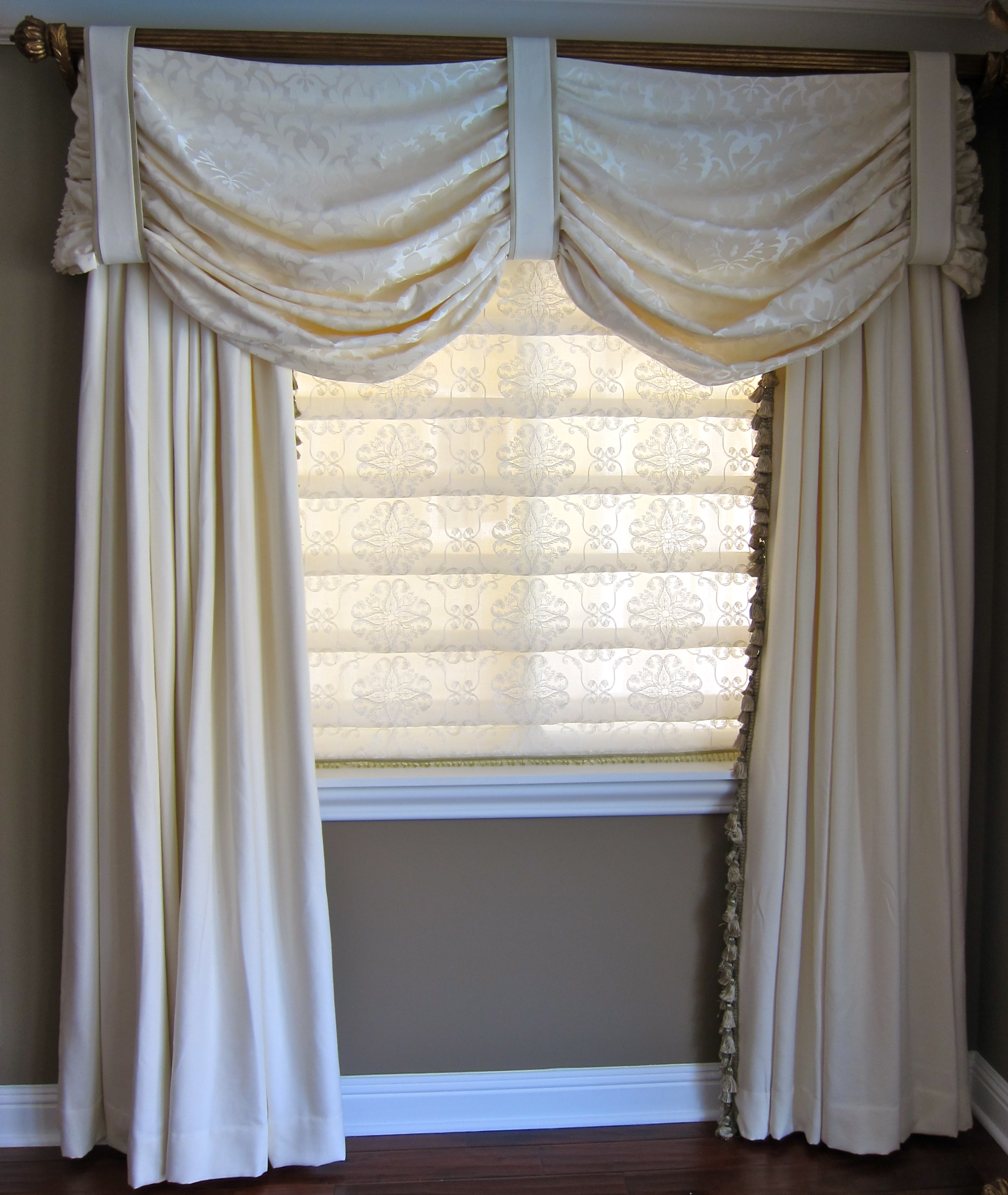 Elegant master suite with gentle swag valance jacoby company